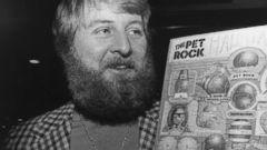 PHOTO: Gary Dahl, originator of the Pet Rock, holds Pet Rock items in 1976.