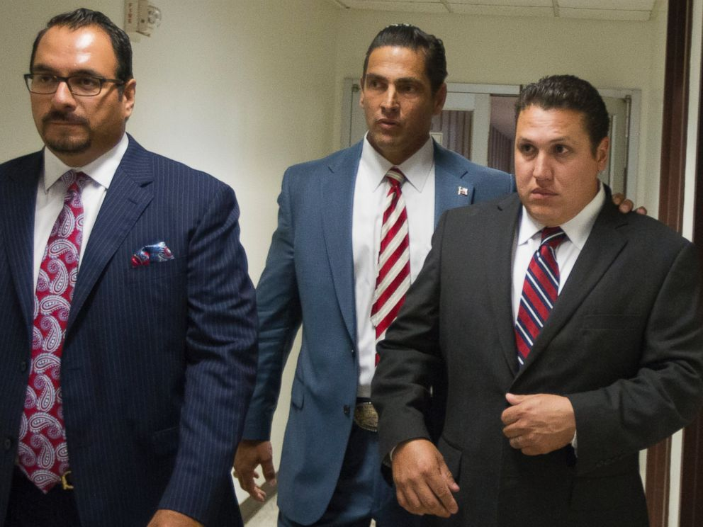 PHOTO: David Barajas, right, walks through the hallway with his attorneys Sam Cammack, center, and Phil Morin as the jury deliberates at the Brazoria County Courthouse on Aug. 27, 2014, Angleton, Texas.