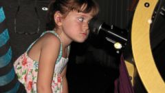 PHOTO: Elizabeth ?Lizzy? Myers, 5, gazes through a telescope at the Warren Rupp Observatory, July 28, 2015, in Bellville, Ohio.
