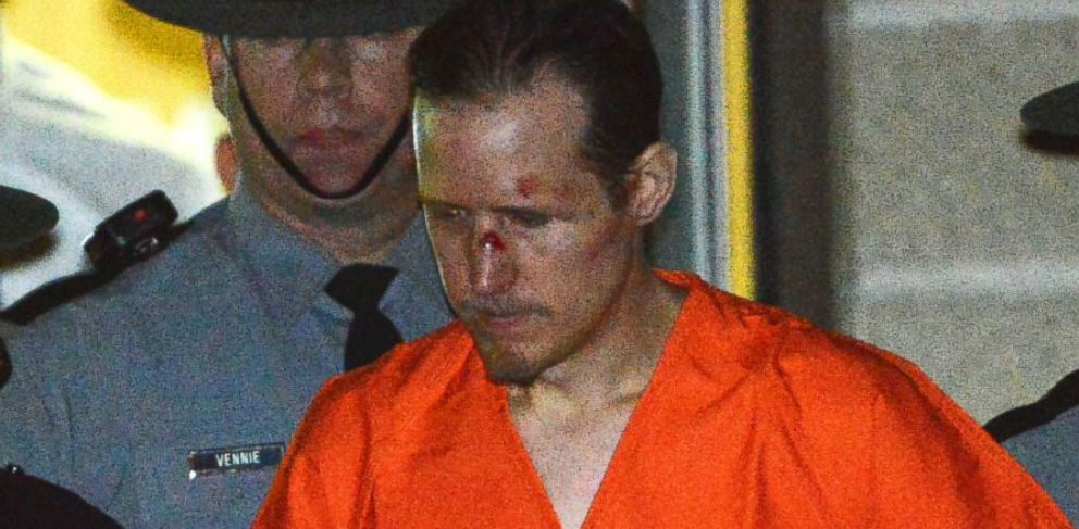 State troopers escort Eric Matthew Frein from the Blooming Grove barracks early Friday Oct. 31, 2014. Frein, accused of opening fire on the barracks Sept. 12, was arrested Thursday.