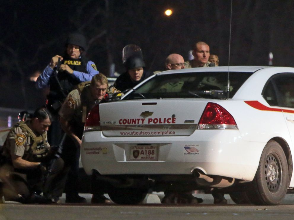 PHOTO: Police mobilize in the parking lot of the Ferguson Police Station after two police officers were shot while standing guard near the Ferguson Police Station, March 12, 2015.