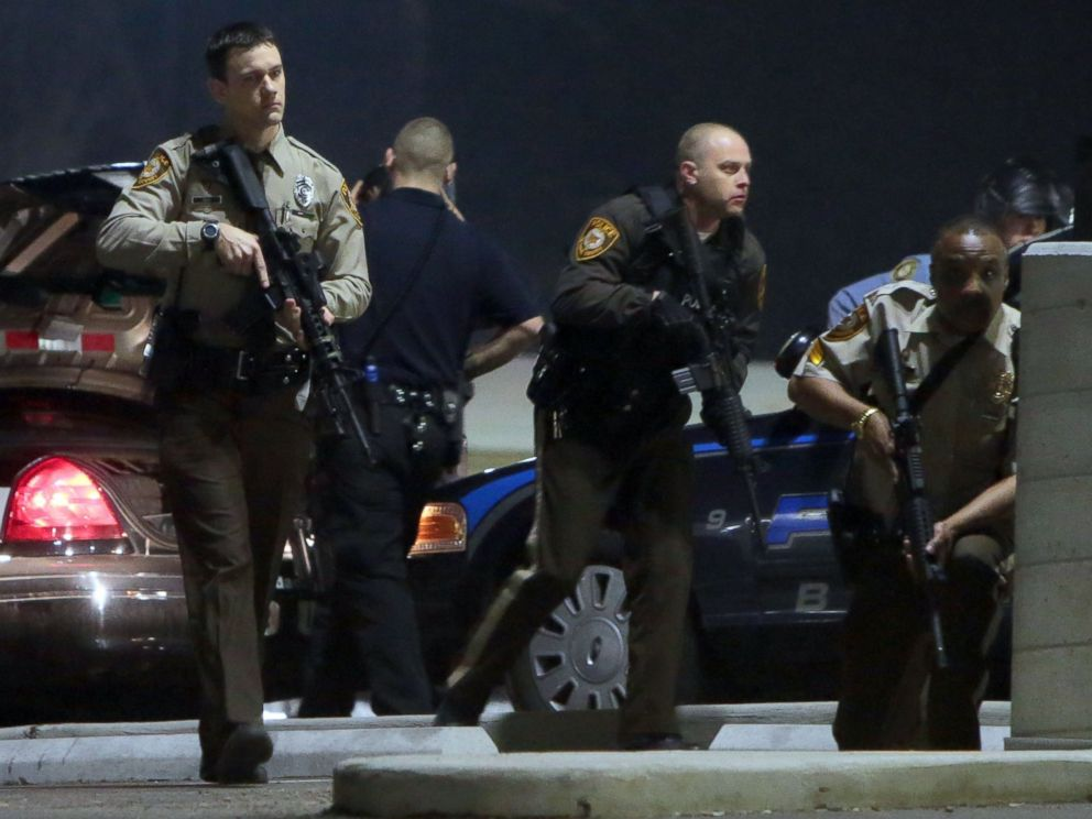 PHOTO: Police mobilize in the parking lot of the Ferguson Police Station after two police officers were shot while standing guard in front of the Ferguson Police Station, March 12, 2015.