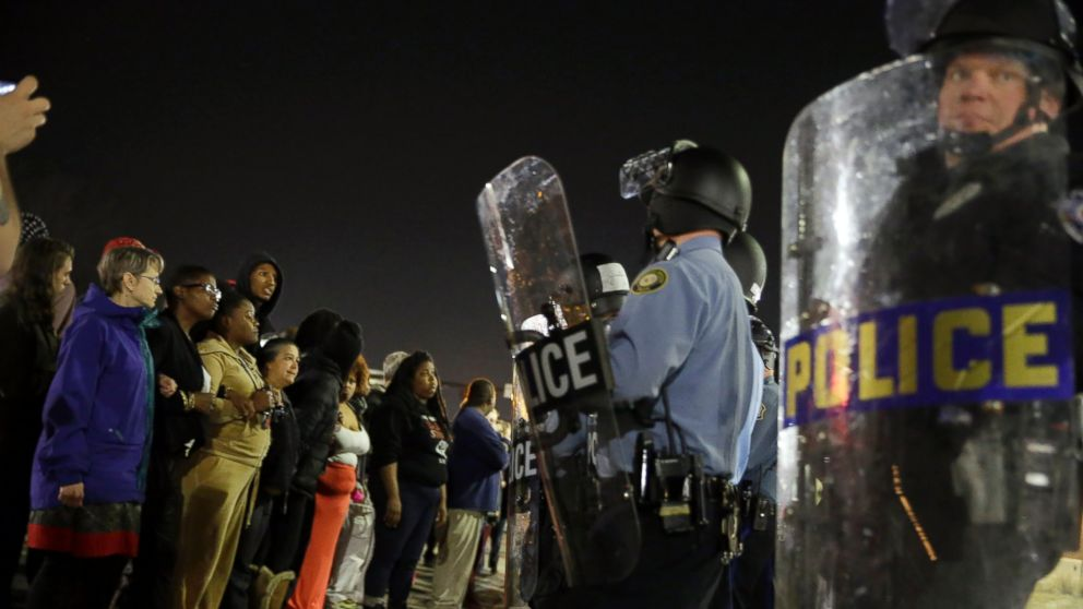 PHOTO: Police and protesters square off outside the Ferguson Police Department, March 11, 2015, in Ferguson, Mo.