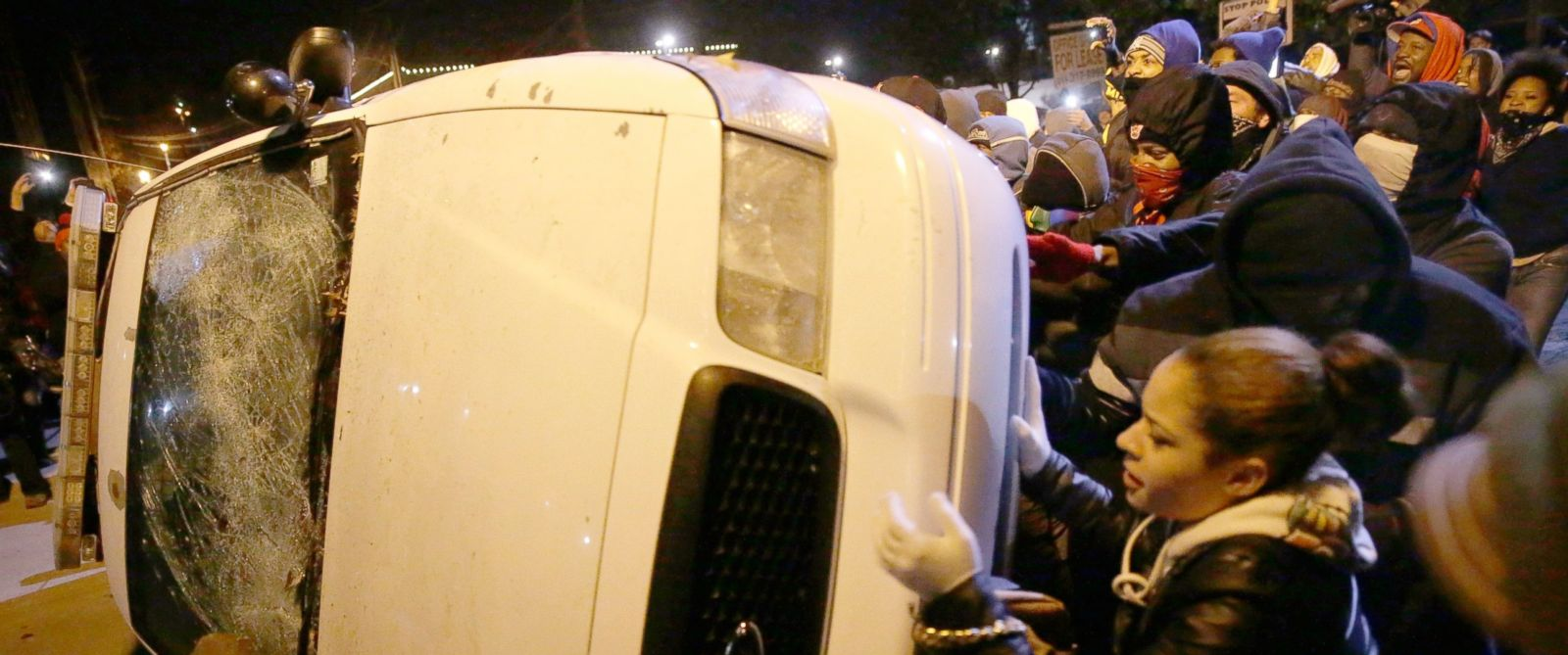 PHOTO: Protesters vandalize a police vehicle outside of the Ferguson city hall, Nov. 25, 2014, in Ferguson, Mo.