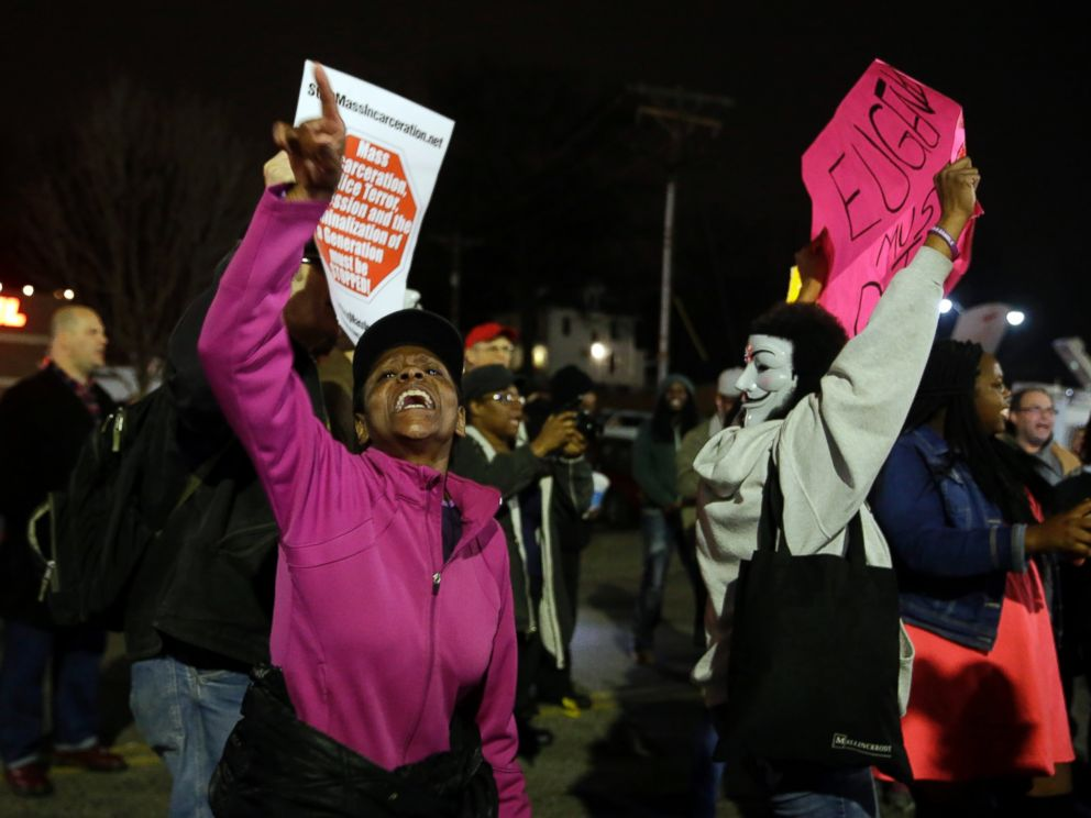PHOTO: People demonstrate across the street from the Ferguson Police Department, March 12, 2015, in Ferguson, Mo.