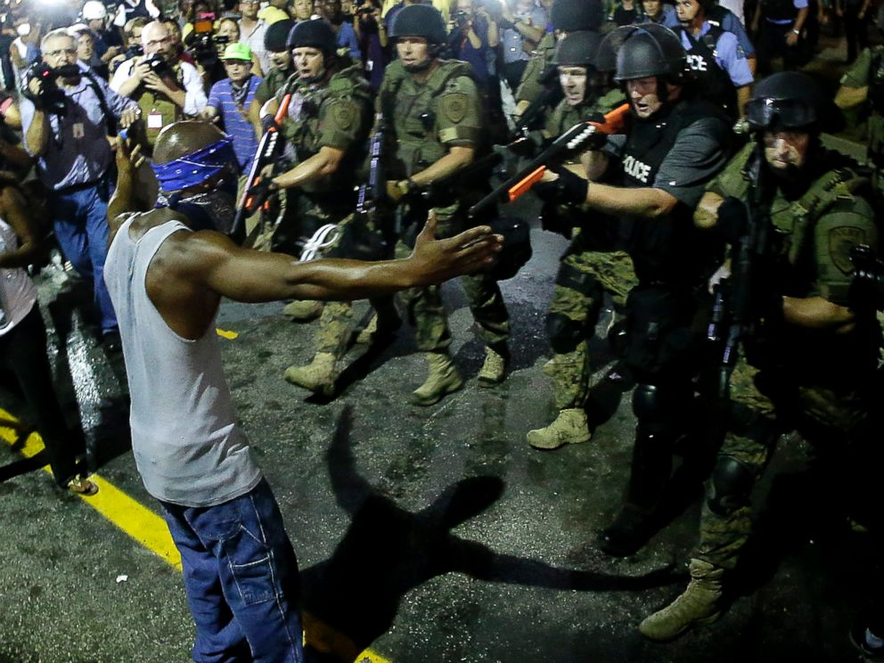 PHOTO: Police arrest a man as they disperse a protest in Ferguson, Mo., Aug. 20, 2014.