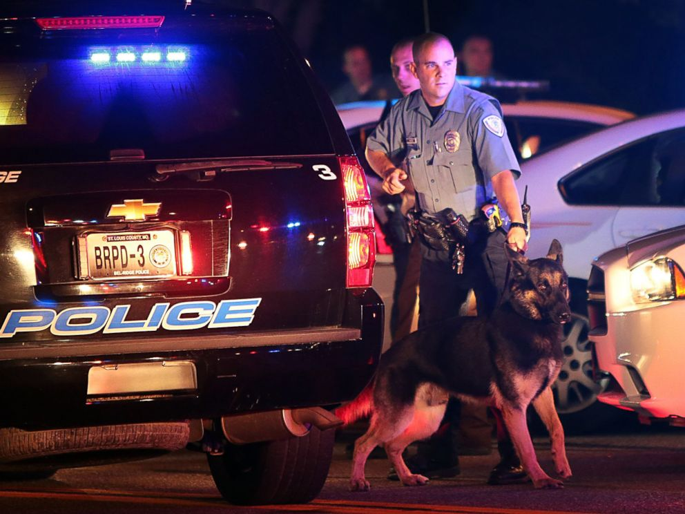 PHOTO: Police officers patrol in Ferguson, Mo., Aug. 10, 2014, following protests after a vigil for Michael Brown, 18.