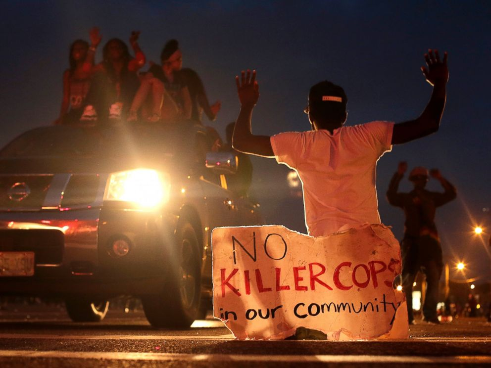 PHOTO: People protest against the shooting death of Michael Brown, Aug. 17, 2014 in Ferguson, Mo.
