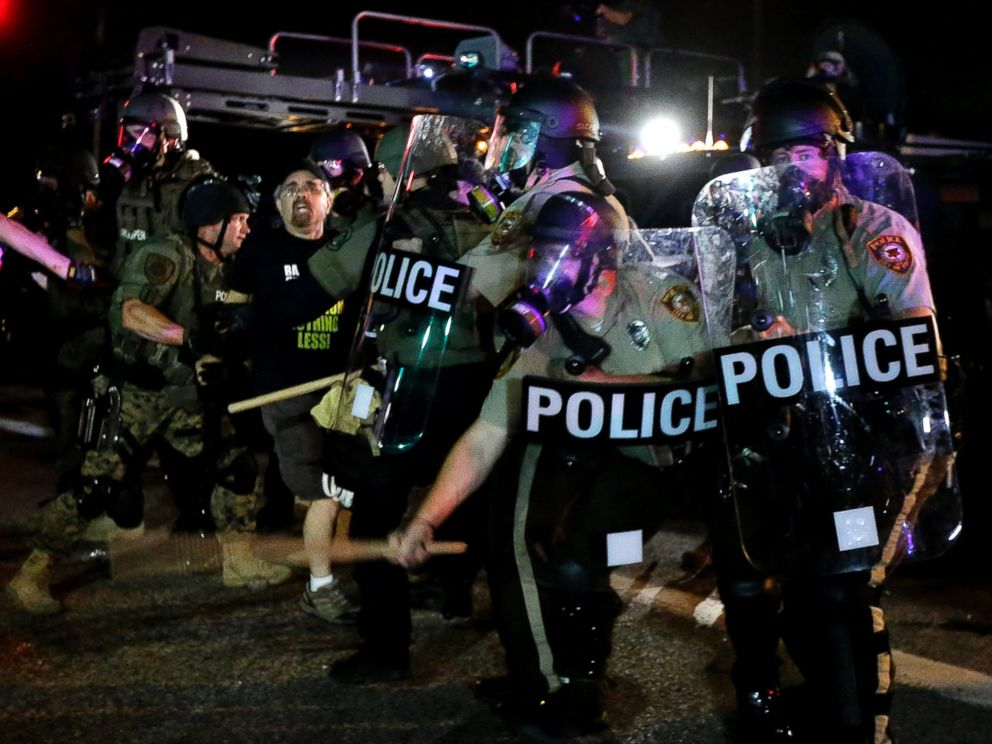 PHOTO: A man is detained after a standoff with police, Aug. 18, 2014, in Ferguson, Mo.