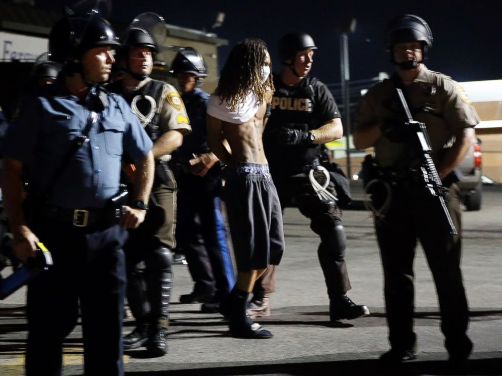 PHOTO: A man is arrested as police try to disperse a crowd in Ferguson, Mo., Aug. 20, 2014.