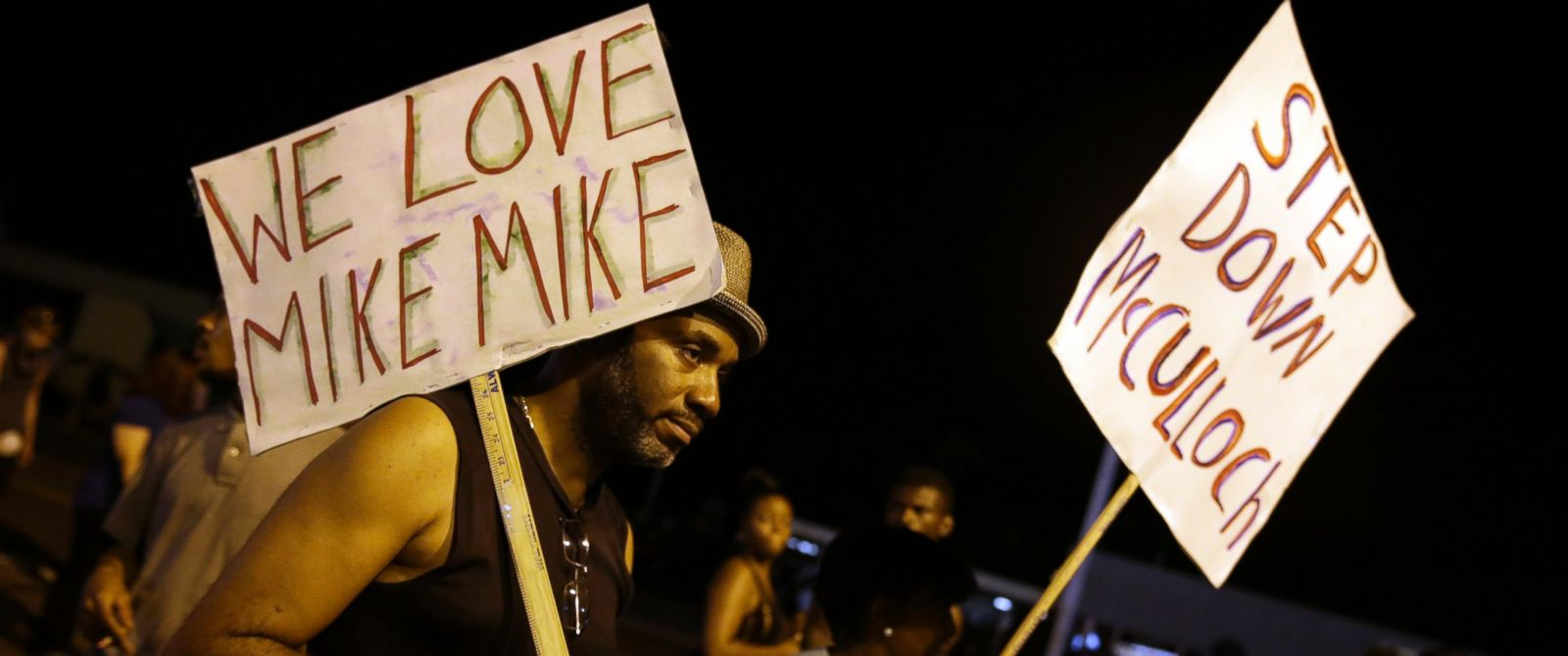 PHOTO: Protesters march, Aug. 21, 2014, in Ferguson, Mo., walking in laps near the spot where Michael Brown was shot.