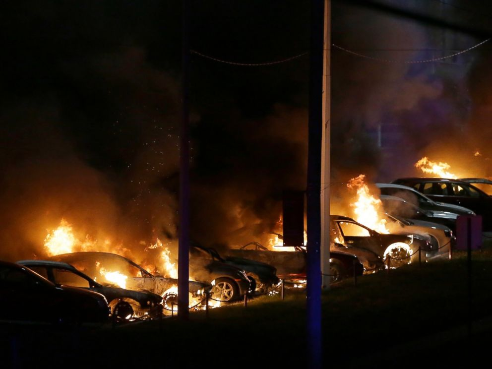 PHOTO: Cars burn at a used car dealership, Nov. 25, 2014, in Dellwood, Mo.