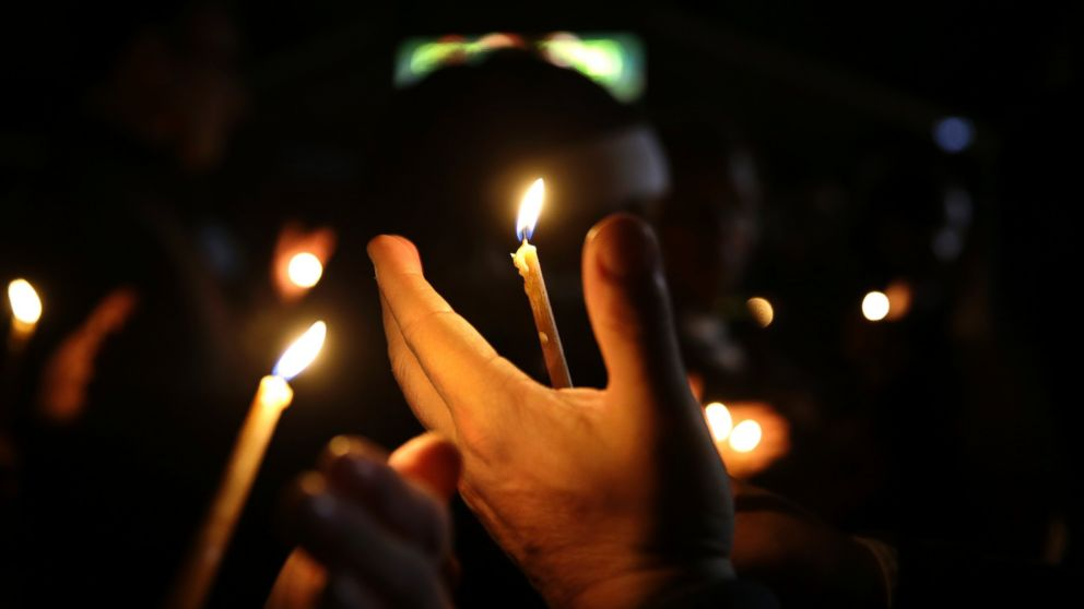 PHOTO: People take part in a candlelight vigil, March 12, 2015, in Ferguson, Mo.