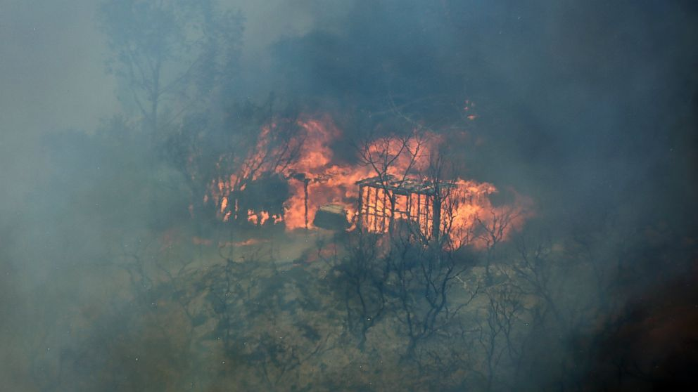 PHOTO: The skeleton shell of a home is engulfed in flames, May 15, 2014, in San Marcos, Calif.