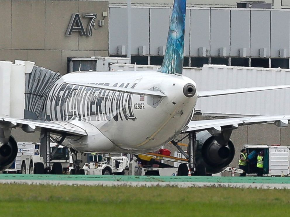 PHOTO: Two workers unload bags from the Frontier Airlines plane that Amber Vinson traveled in from Cleveland to Dallas, at a terminal at Cleveland Hopkins International Airport, Oct. 15, 2014, in Cleveland.