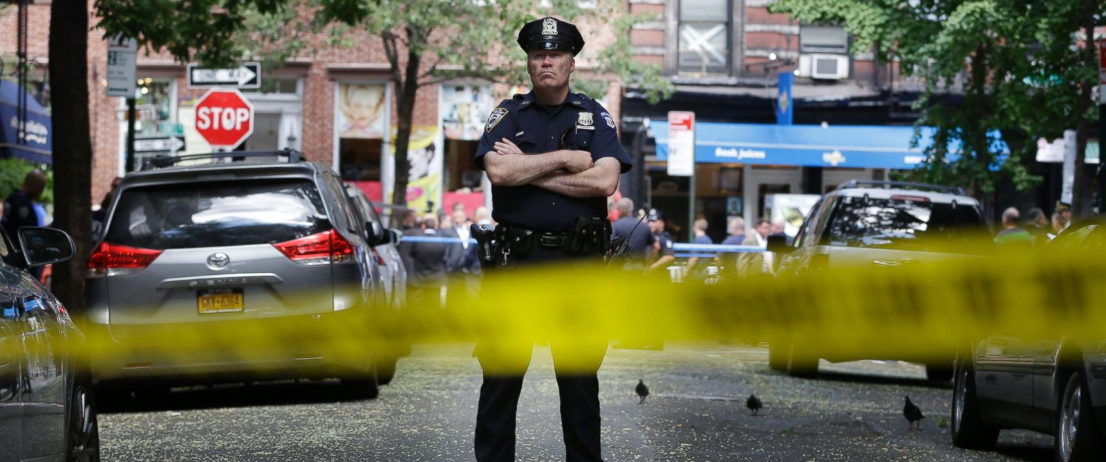 PHOTO: A police officer stands near the scene of a shooting at a New York City cigar shop, July 28, 2014.