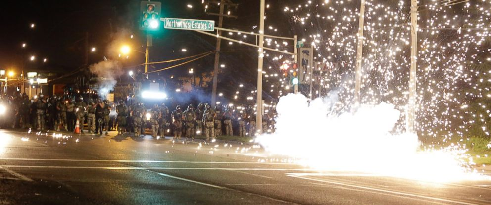 PHOTO: A device deployed by police goes off in the street as police and protesters clash Wednesday, Aug. 13, 2014, in Ferguson, Mo., the St. Louis suburb where an unarmed black teen was shot and killed by a police officer.