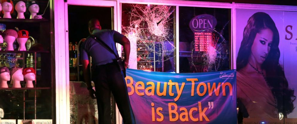 PHOTO: A Missouri Highway Patrol trooper looks inside the vandalized Beauty Town store on West Florissant Avenue in Ferguson, Mo., Sept. 23, 2014.