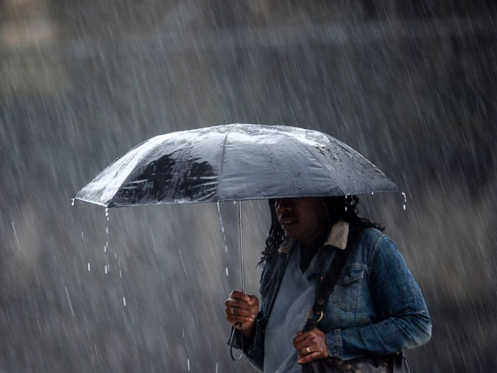 PHOTO: A pedestrian crosses the street in a rainstorm, April 30, 2014, in Philadelphia.