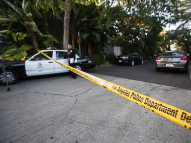 PHOTO: An officer stands outside a home in the Hollywood Hills area of Los Angeles, March 31, 2015. Police say a man was found dead at the home of Andrew Getty, heir to Getty oil fortune.