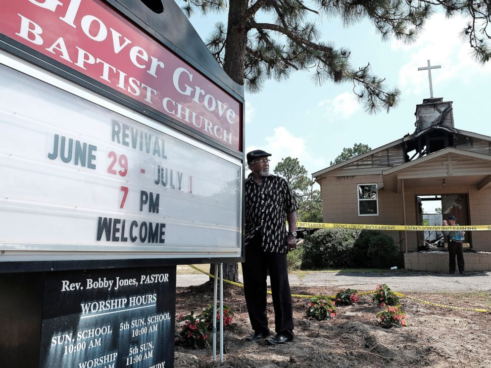PHOTO: Glover Grove Baptist Church Pastor Bobby Jones stands outside the church that was destroyed by a fire, June 26, 2015, in Warrenville, S.C.