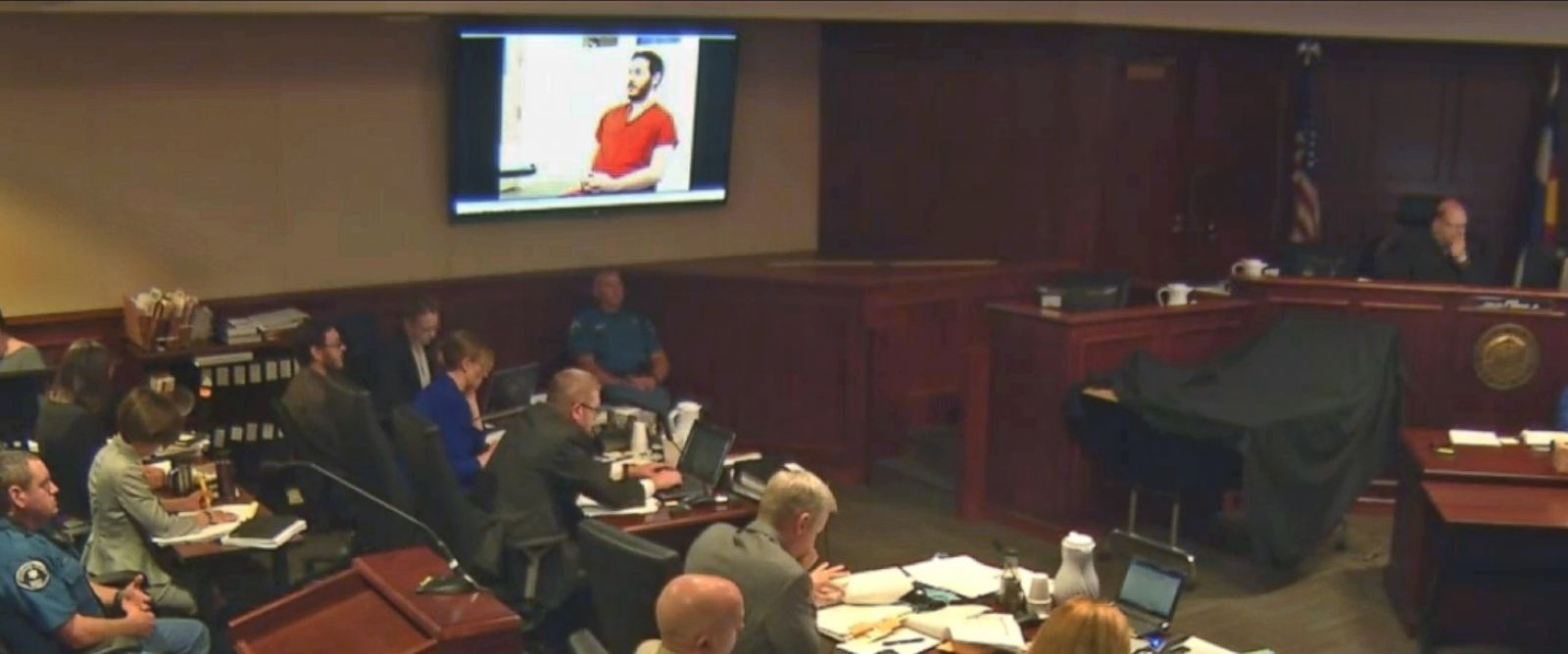 PHOTO: James Holmes appears in a video presented to a darkened courtroom in Centennial, Colo., June 4, 2015.