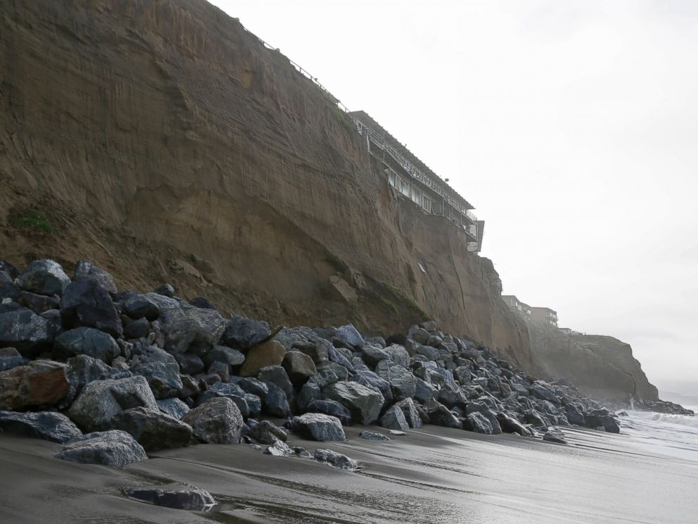 PHOTO: Boulders shore up an eroding cliff below an apartment complex, Jan. 25, 2016, in Pacifica, Calif. Strong waves caused by El Nino storms ate away part of a sea wall and cliffs threatening several homes and an apartment building.