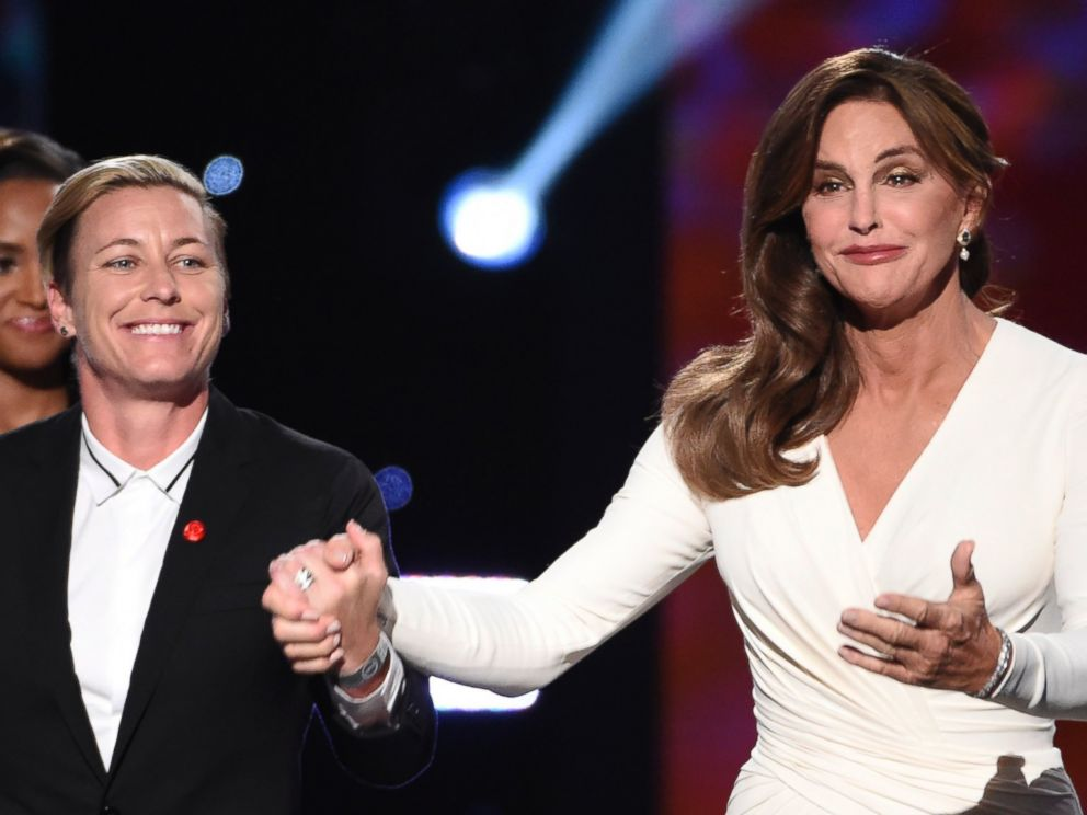 PHOTO: Soccer player Abby Wambach, of the U.S. womens national soccer team, left, presents Caitlyn Jenner with the Arthur Ashe award for courage at the ESPY Awards at the Microsoft Theater on Wednesday, July 15, 2015, in Los Angeles.