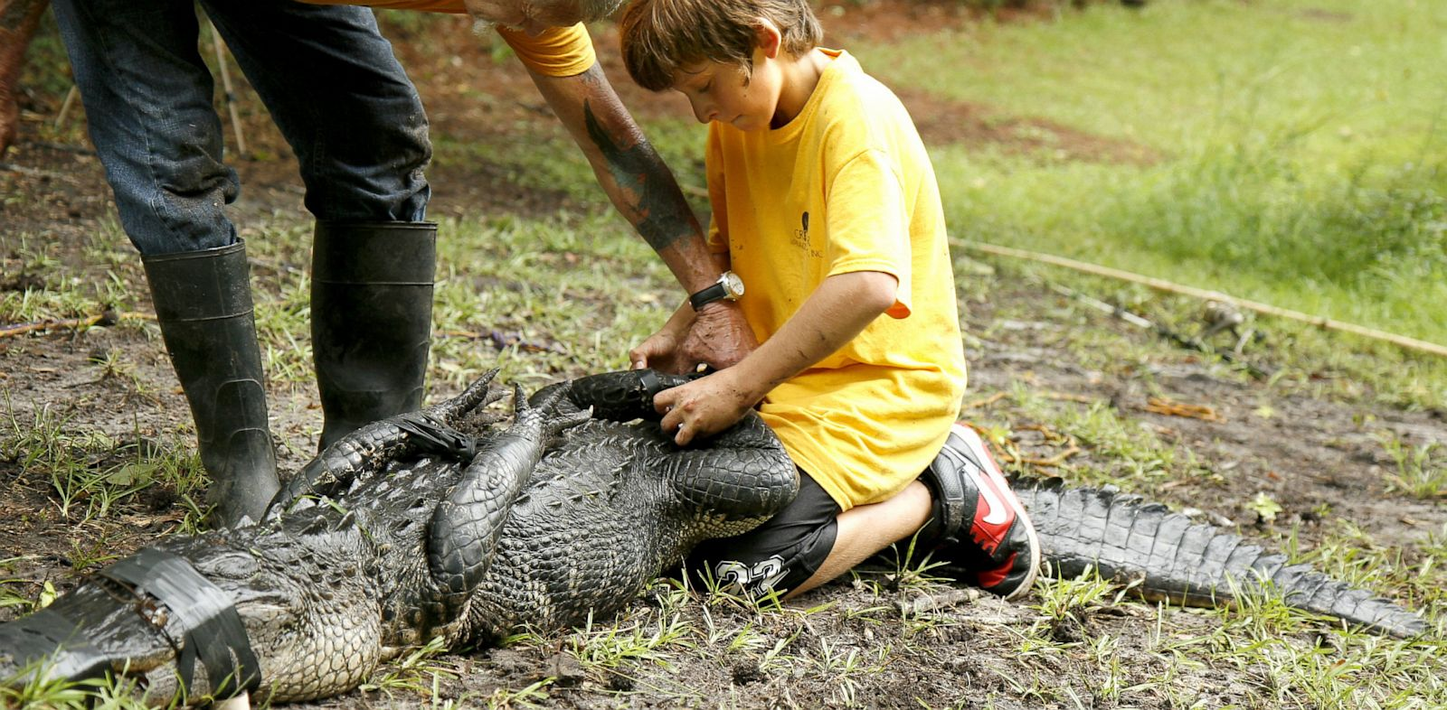PHOTO: Joey and Joe Maffo with alligator