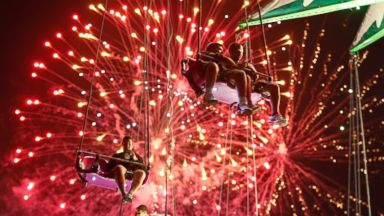 PHOTO: People hang from the Sky Flyer ride at the State Fair Meadowlands during a Fourth of July fireworks display, Friday, July 3, 2015, in East Rutherford, N.J.