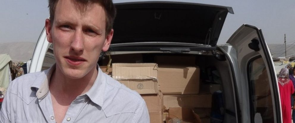 PHOTO: This undated photo released by the Kassig family Oct. 5, 2014 shows Abdul-Rahman Kassig standing in front of a truck filled with supplies for Syrian refugees.