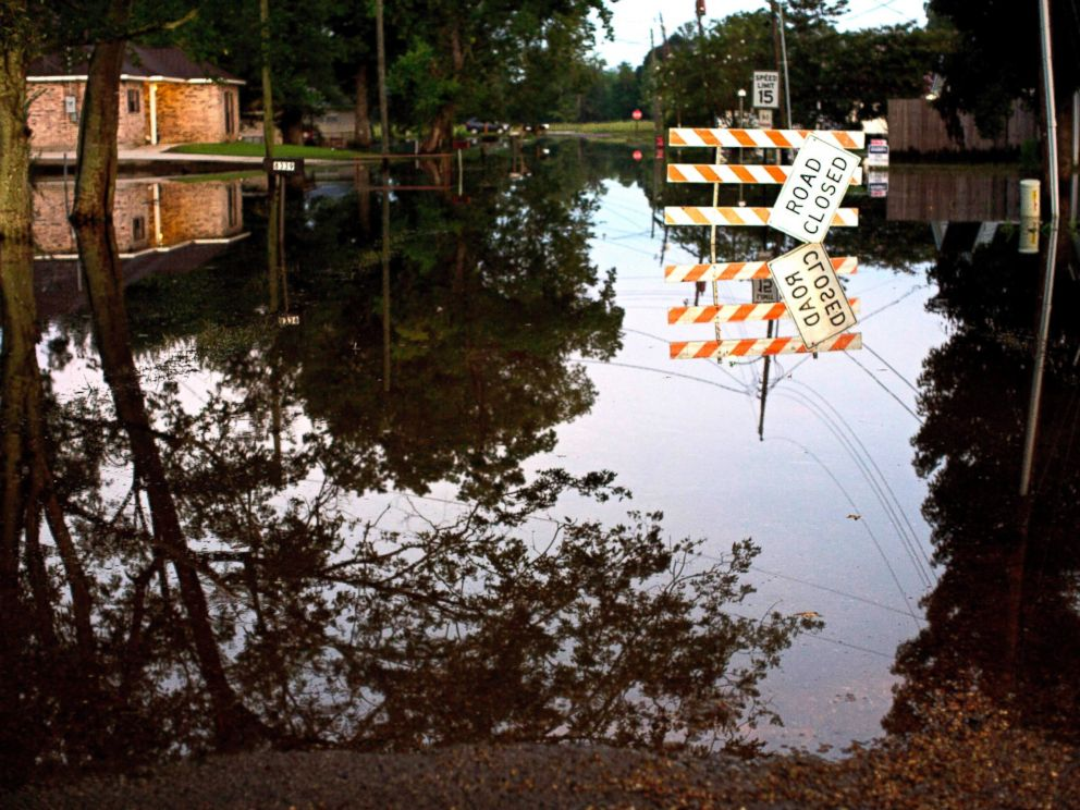 PHOTO: Standing water closes roads, Aug. 20, 2016, in Sorrento, Louisiana.