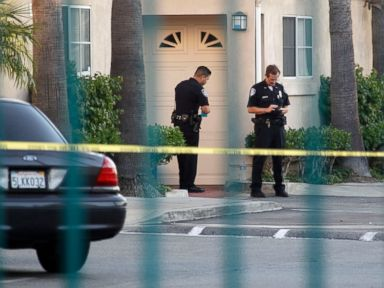 PHOTO: Police officers stand by the scene of a shooting in Bell Gardens, Calif., Sept. 30, 2014.