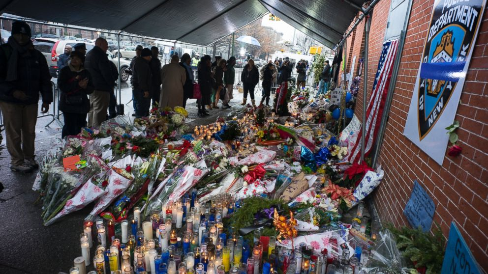 PHOTO: Candles and other items left by visitors make up a growing makeshift memorial, Dec. 23, 2014, near the site where New York Police Department officers Rafael Ramos and Wenjian Liu were murdered in the Brooklyn borough of New York.