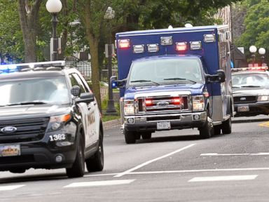 PHOTO: An ambulance speeds north in St. Paul, Minn., July 30, 2014, following a shooting.