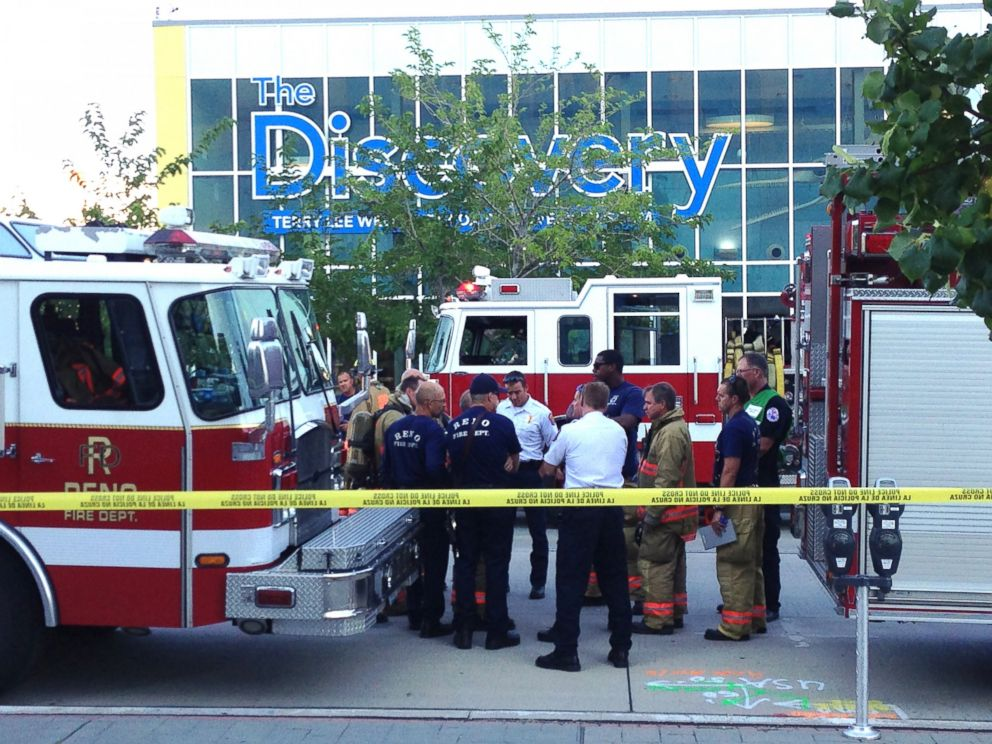 PHOTO: Firefighters stand outside the Discovery Museum in Reno, Nev., Sept. 3, 2014, after a demonstration malfunctioned.