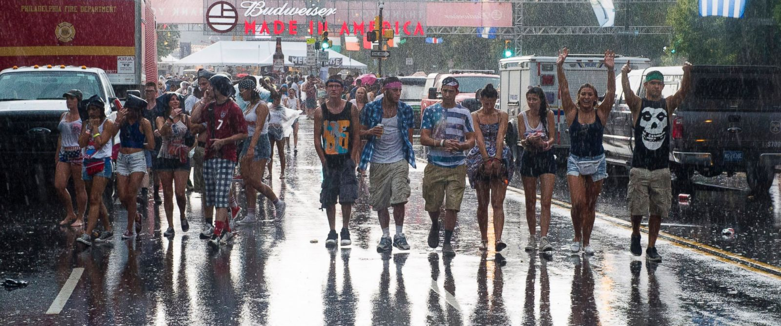 Concert goers leave the Made in America Festival after the grounds are evacuated due to thunderstorms on Sunday, Aug. 31, 2014, in Philadelphia.