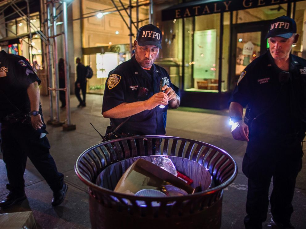 PHOTO: Police officers look for suspicious packages along Fifth Avenue near the scene of an explosion on West 23rd Street and 6th Avenue in Manhattans Chelsea neighborhood, in New York, Sept. 18, 2016.