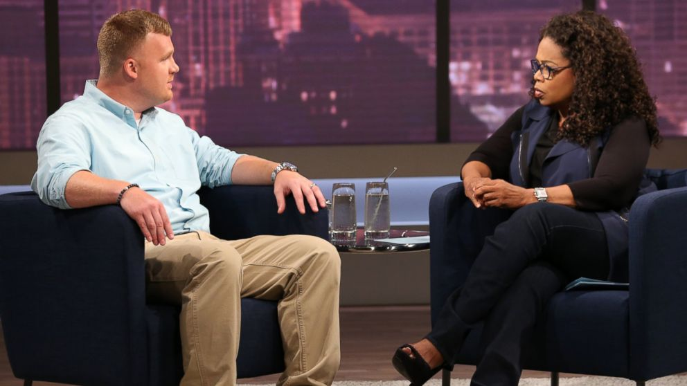 Matt Sandusky, the adopted son of former Penn State University assistant football coach Jerry Sandusky, talks with Oprah Winfrey, June 27, 2014.