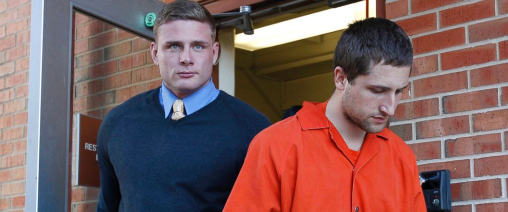 PHOTO: Micah Moore right, is escorted into the Jackson County Courthouse Annex in Independence, Mo., to face a first-degree murder charge in this Nov. 13, 2013 file photo.