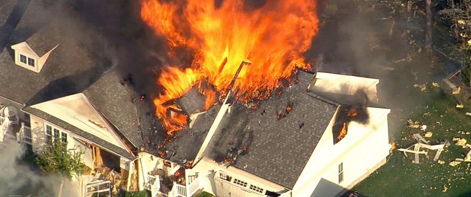 PHOTO: In this frame grab from television helicopter video, a home bursts into flames in Brentwood, N.H., May 12, 2014.