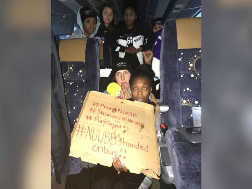PHOTO: This photo provided by Chelsea Andorka, the Niagara University women's basketball team spokeswoman, shows the team holding a sign while their bus was snowbound near Lackawanna, N.Y., Nov. 18, 2014.