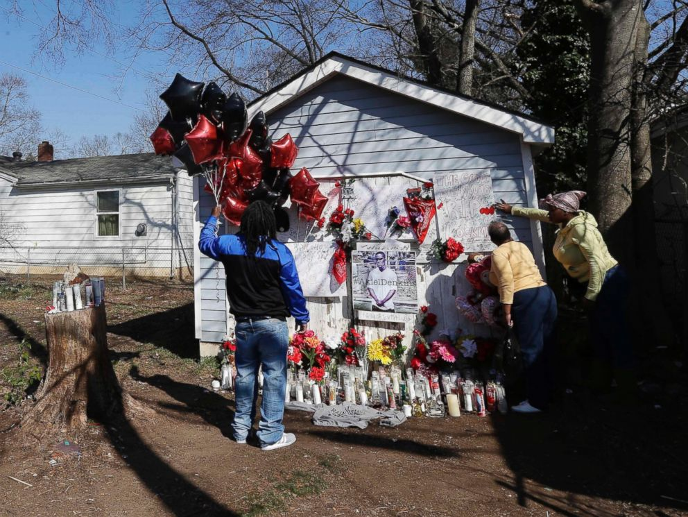 PHOTO: People gather at a makeshift memorial near the scene of a shooting in Raleigh, N.C.,March 1, 2016. Authorities say that a police officer fatally killed a man on Monday while trying to make an arrest for a felony drug charge.