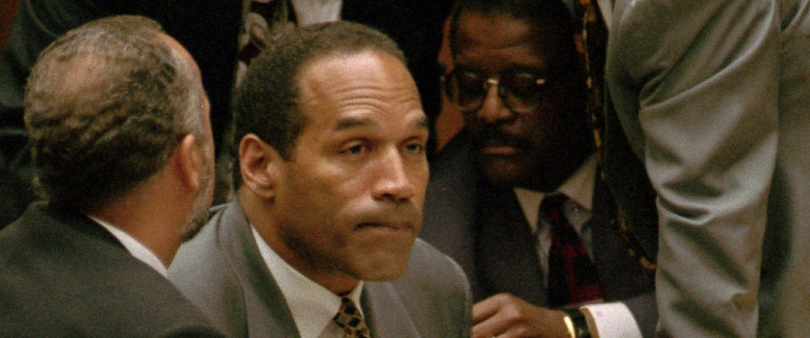 PHOTO:O.J. Simpson is surrounded by his attorneys in court, Aug. 29, 1995, in Los Angeles.