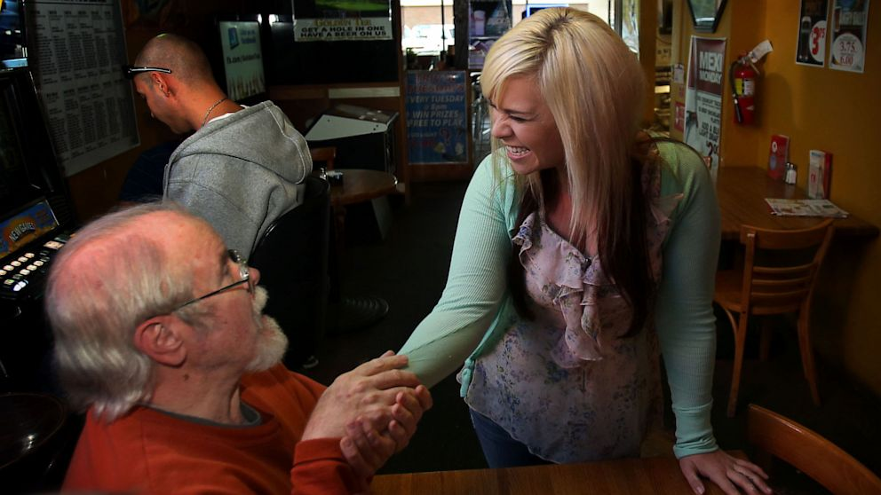 PHOTO: Bartender Aurora Kephart receives winning lottery ticket worth $17,500