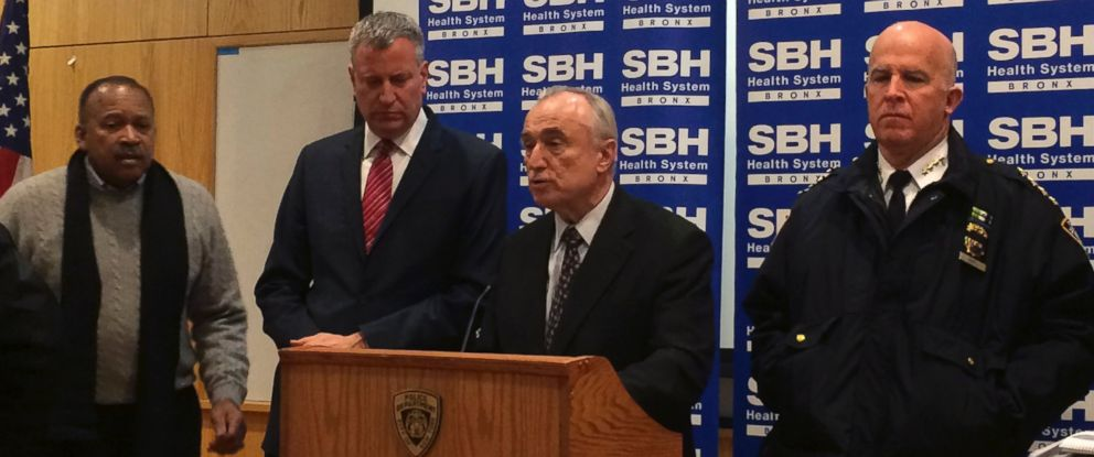 PHOTO: New York City Mayor Bill de Blasio, second left, stands by as Police Commissioner William Bratton, second right, speaks at a news conference at St. Barnabas Hospital in the Bronx section of New York City, Jan. 6, 2015.