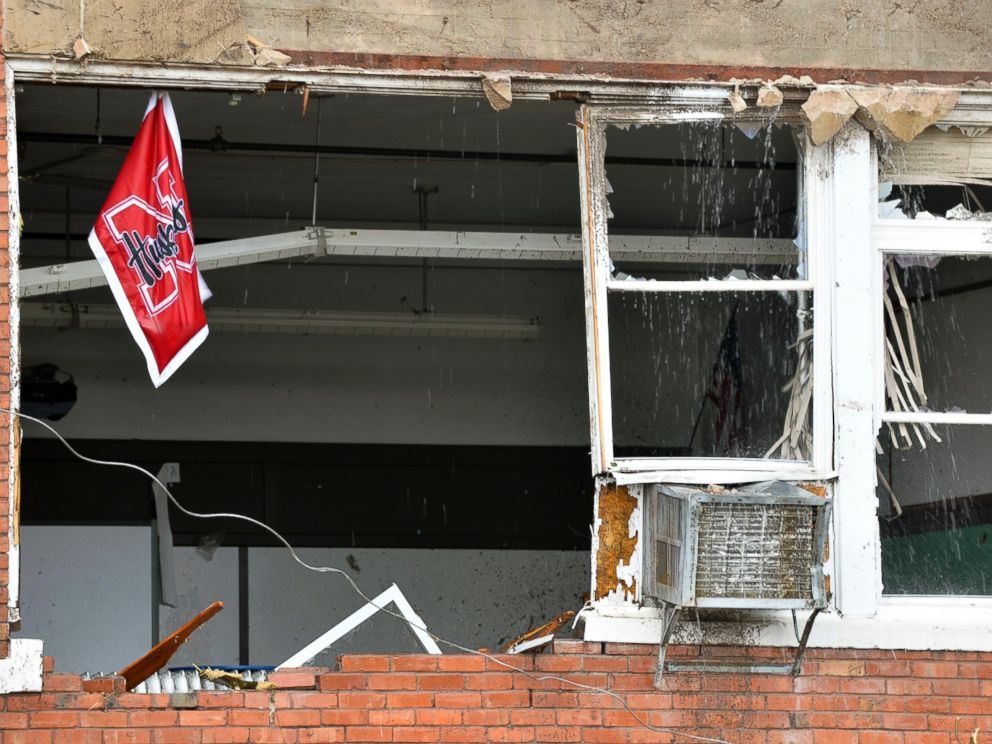 PHOTO: A Husker flag hangs from a window in the heavily damaged school building in Pilger, Neb., June 16, 2014.