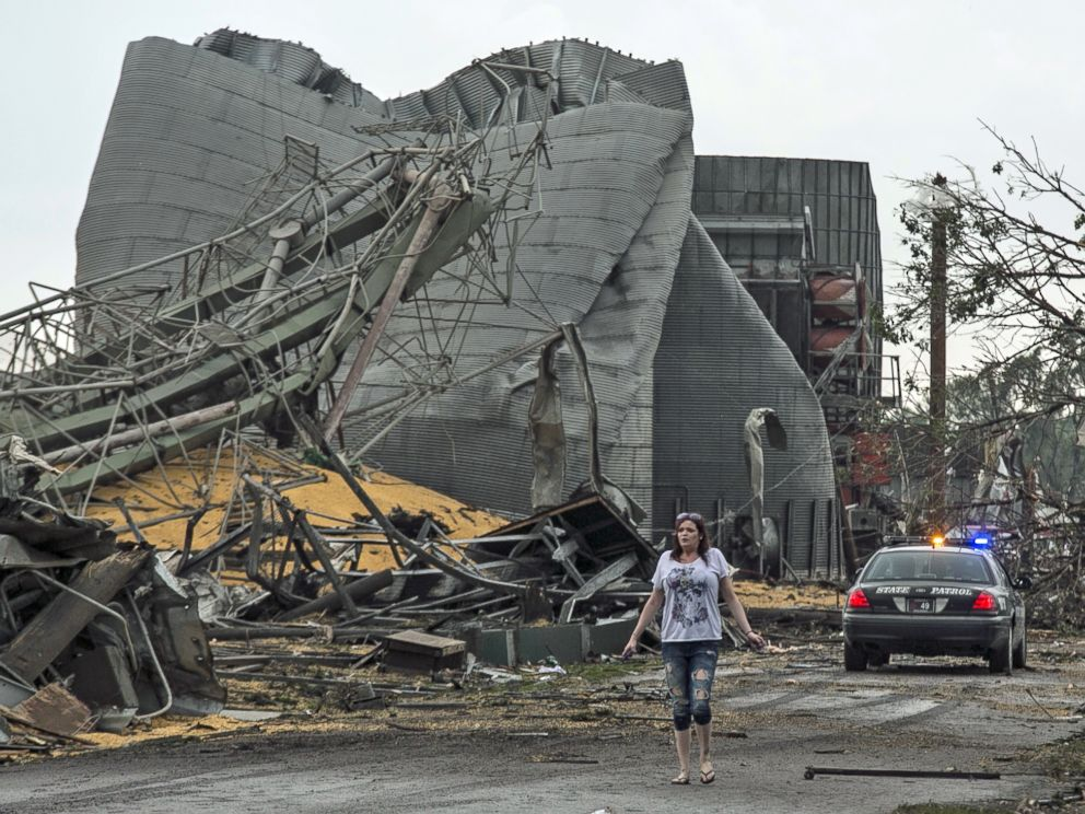 PHOTO: A woman walks down Black Hills Trail road in Pilger, Neb., June 16, 2014.