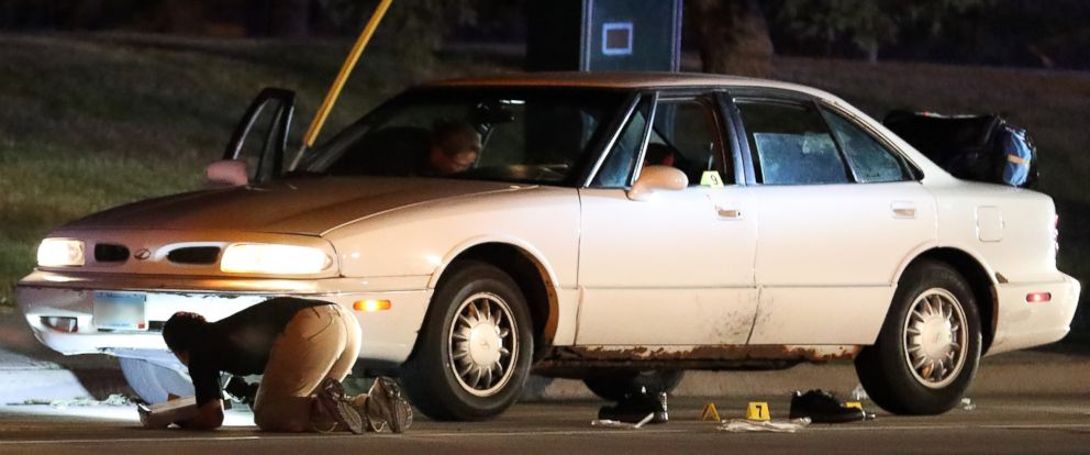 PHOTO: Investigators search a car at the scene of a police involved shooting, July 6, 2016, in Falcon Heights, Minn.