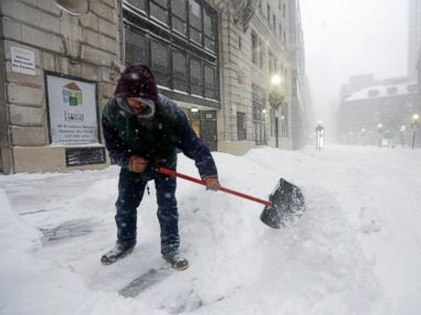 PHOTO: A worker shovels snow from a sidewalk during a winter snowstorm, Jan. 27, 2015, in Boston.